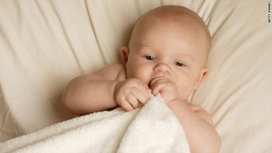 Baby_with_rug