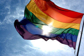 Rainbow_flag_and_blue_skies