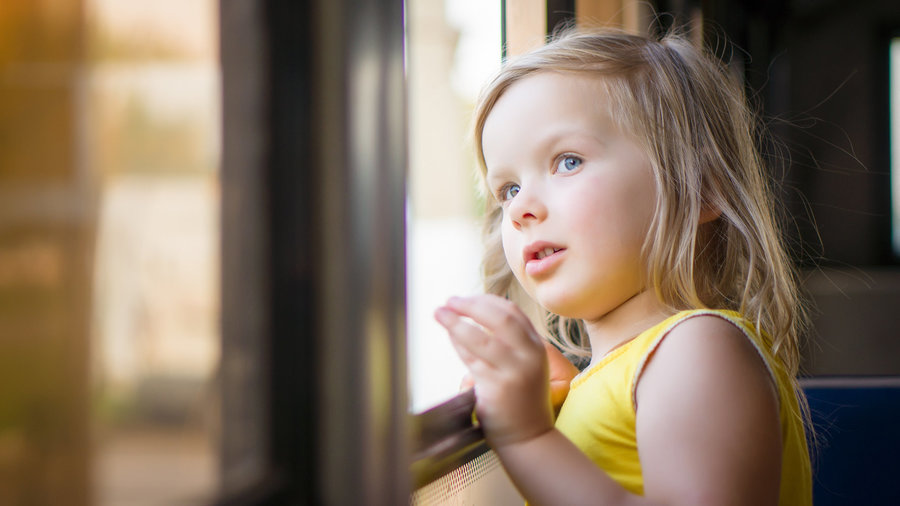 Child_looking_out_window