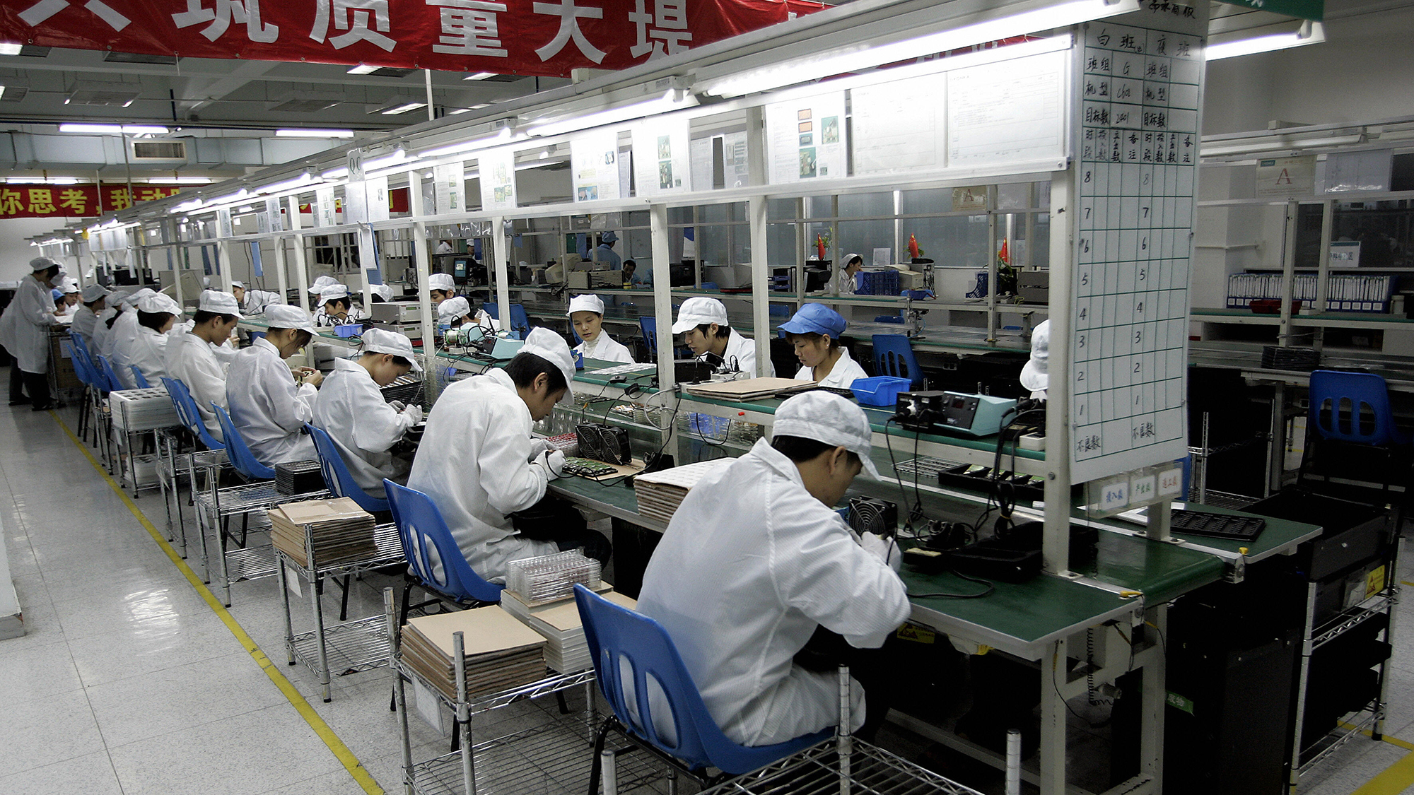 Chinese workers producing mobile phone handsets in Guangdong province.