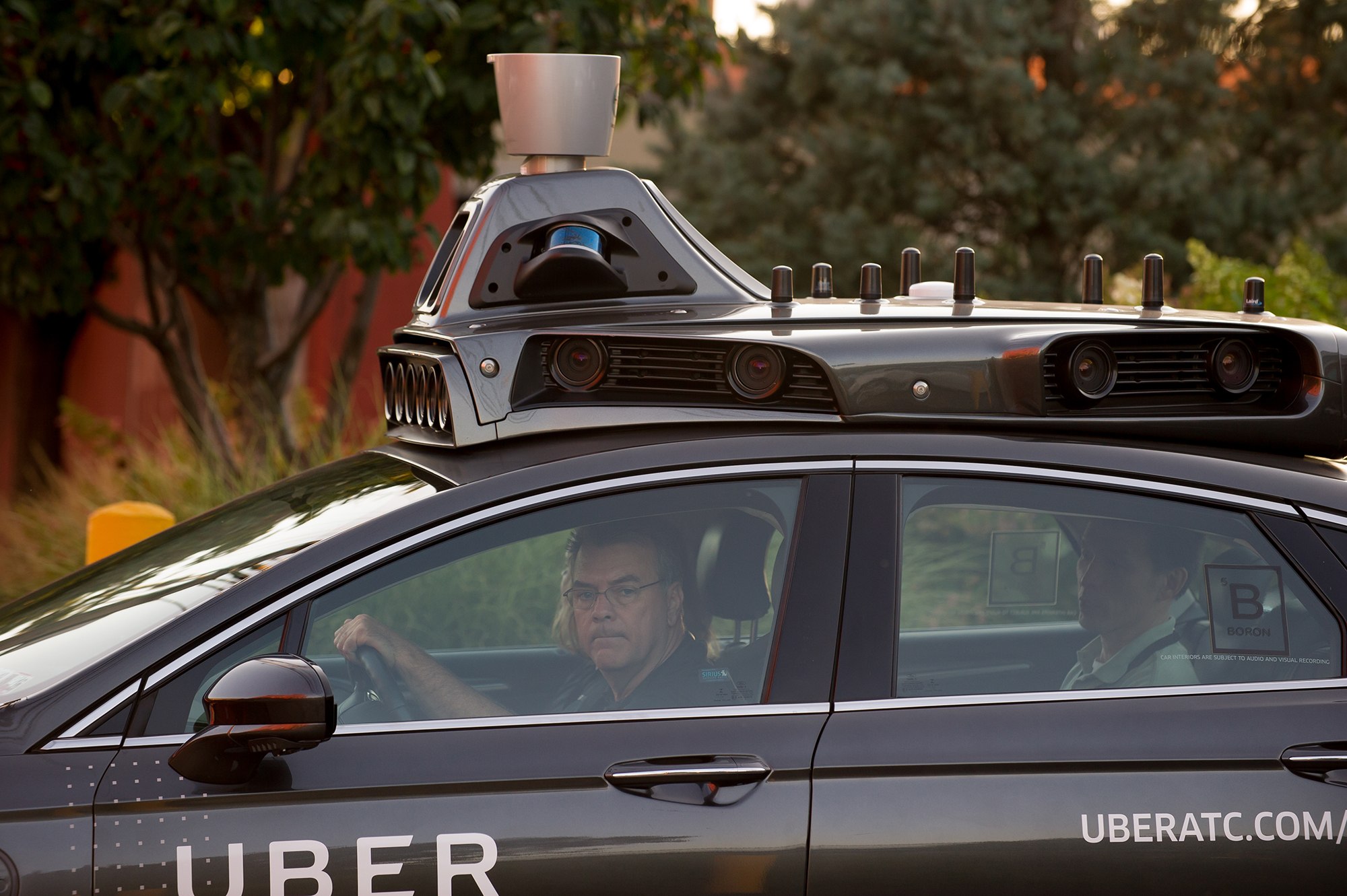 An Uber driverless Ford Fusion drives down Smallman Street on September, 22, 2016 in Pittsburgh, Pennsylvania. Uber has built its Uber Technical Center in Pittsburgh and is developing an autonomous vehicle that it hopes will be able to transport its millions of clients without the need for a driver. (Photo by Jeff Swensen/Getty Images)