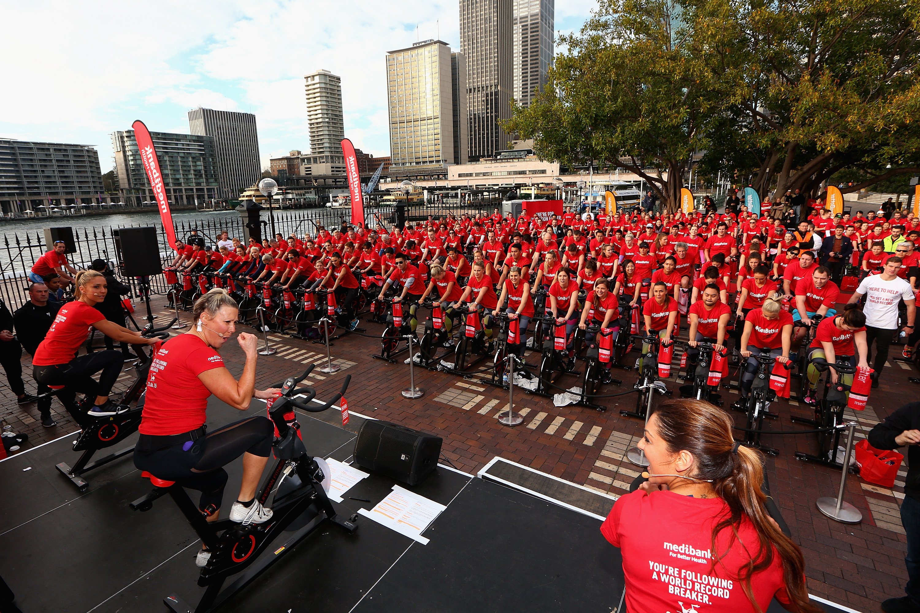 People participate in a Medibank spin class on June 25, 2015 in Sydney, Australia. Medibank, Base Body Babes and Cadel Evans have set a new Guinness World Record for the Largest Spin Class. (Cameron Spencer/Getty Images for Medibank)