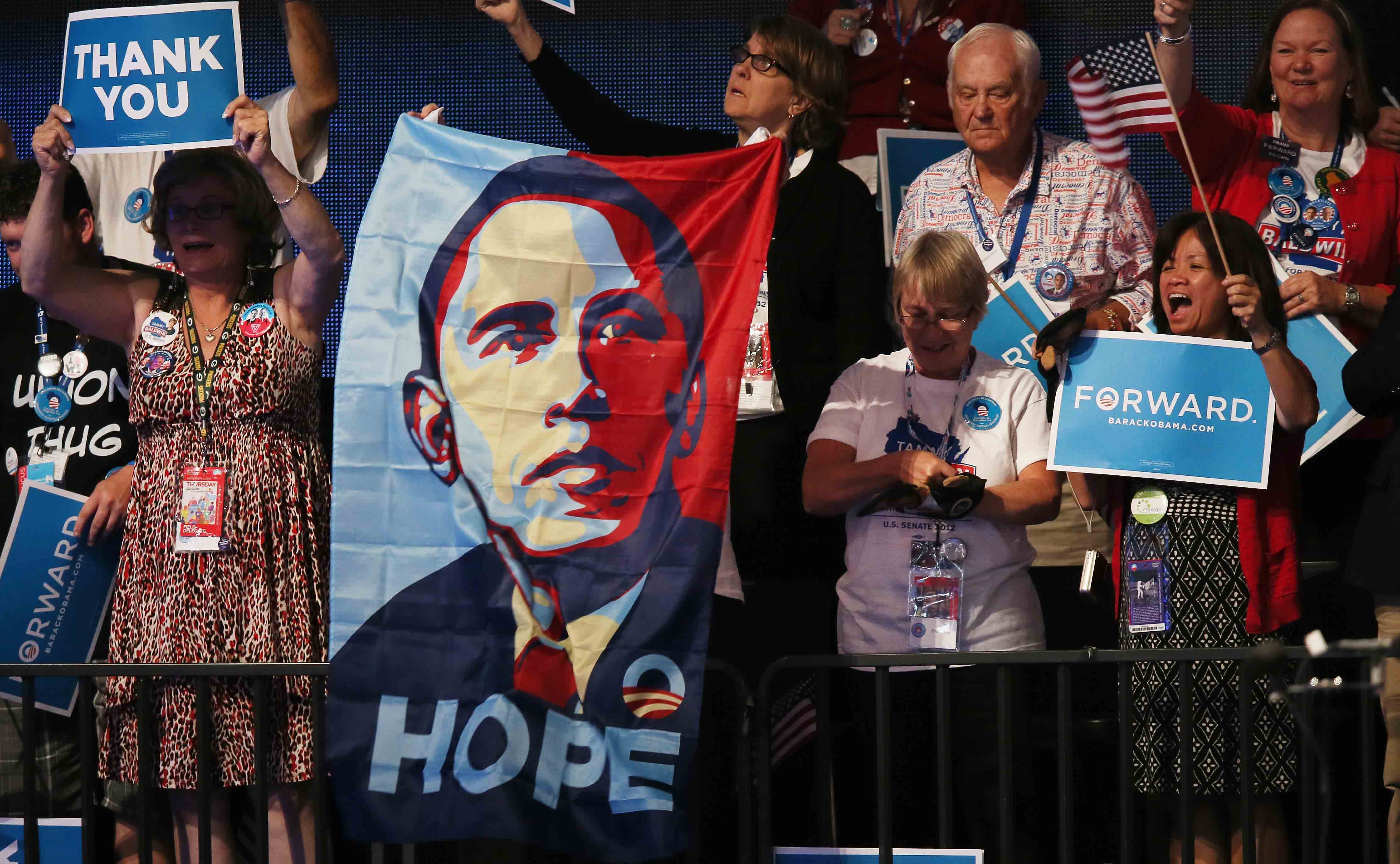 Supporters of President Obama holding a flag containing his image.