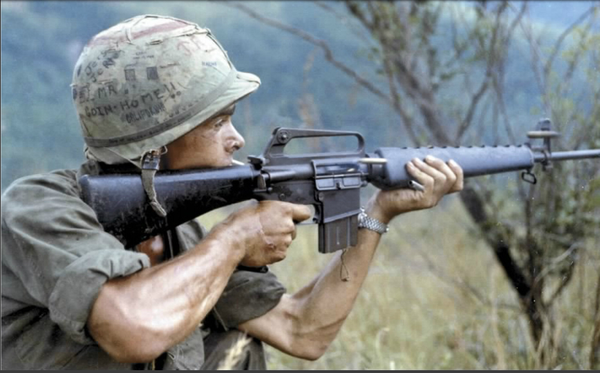 Soldier in Vietnam with M16