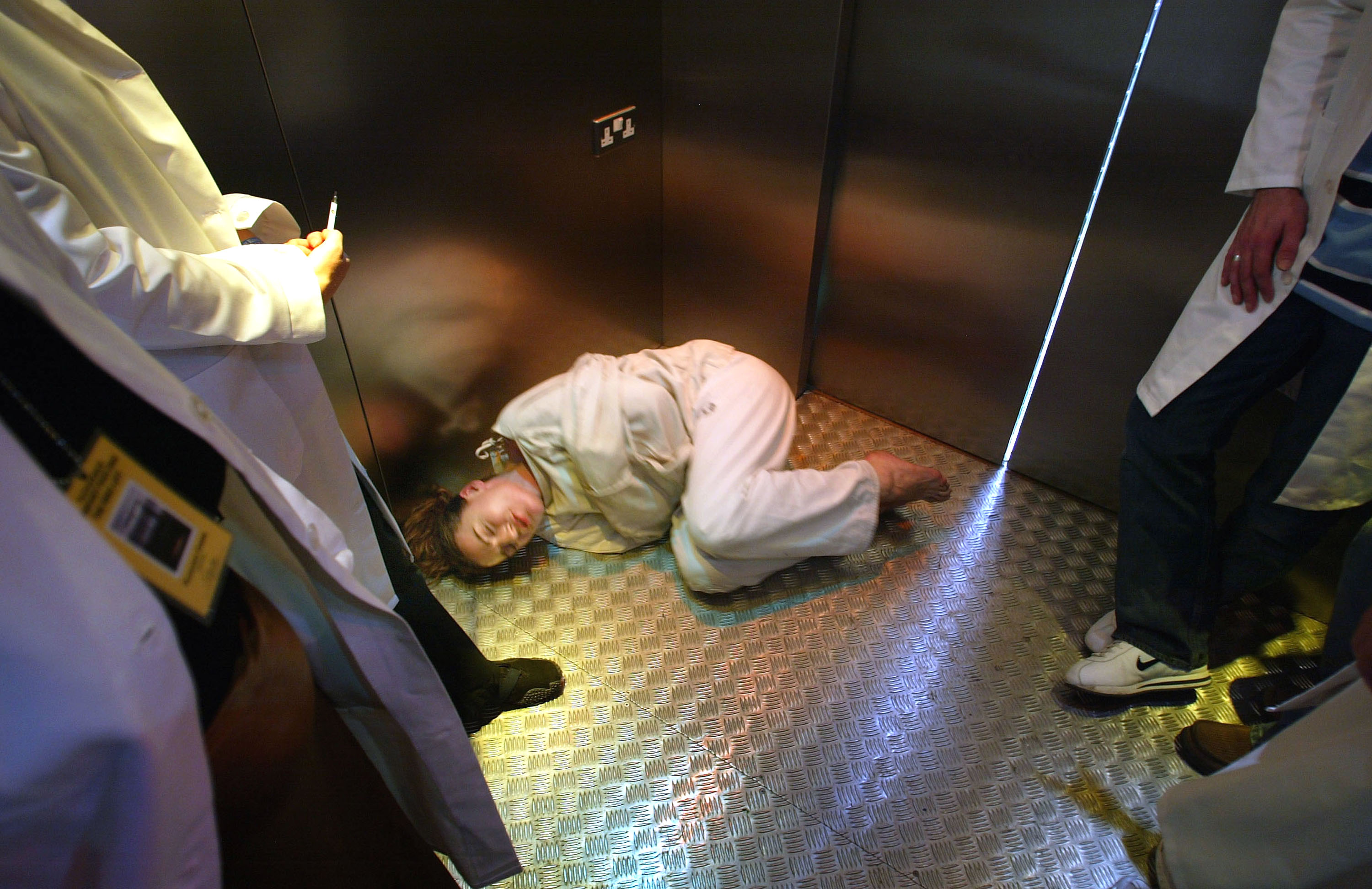 EDINBURGH, SCOTLAND - AUGUST 4: Kiki Kendrick acts in a straitjacket during her solo performance 'Insane Jane' performed inside a lift at the 57th Edinburgh Fringe Festival 2003 August 4, 2003 in Edinburgh, Scotland.