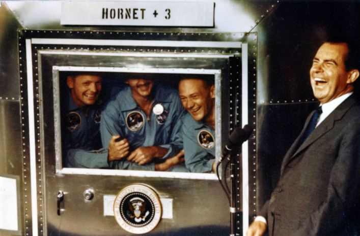 (File) Neil Armstrong Dies at 82 USS HORNET - JULY 24: In this handout photo provided by the Richard Nixon Foundation, Apollo XI astronauts Neil Armstrong, Michael Collins and Buzz Aldrin laugh with President Richard Nixon aboard the USS Hornet, July 24, 1969. The President was on hand to greet the astronauts after their splashdown in the Pacific. (Photo by Richard Nixon Foundation via Getty Images)