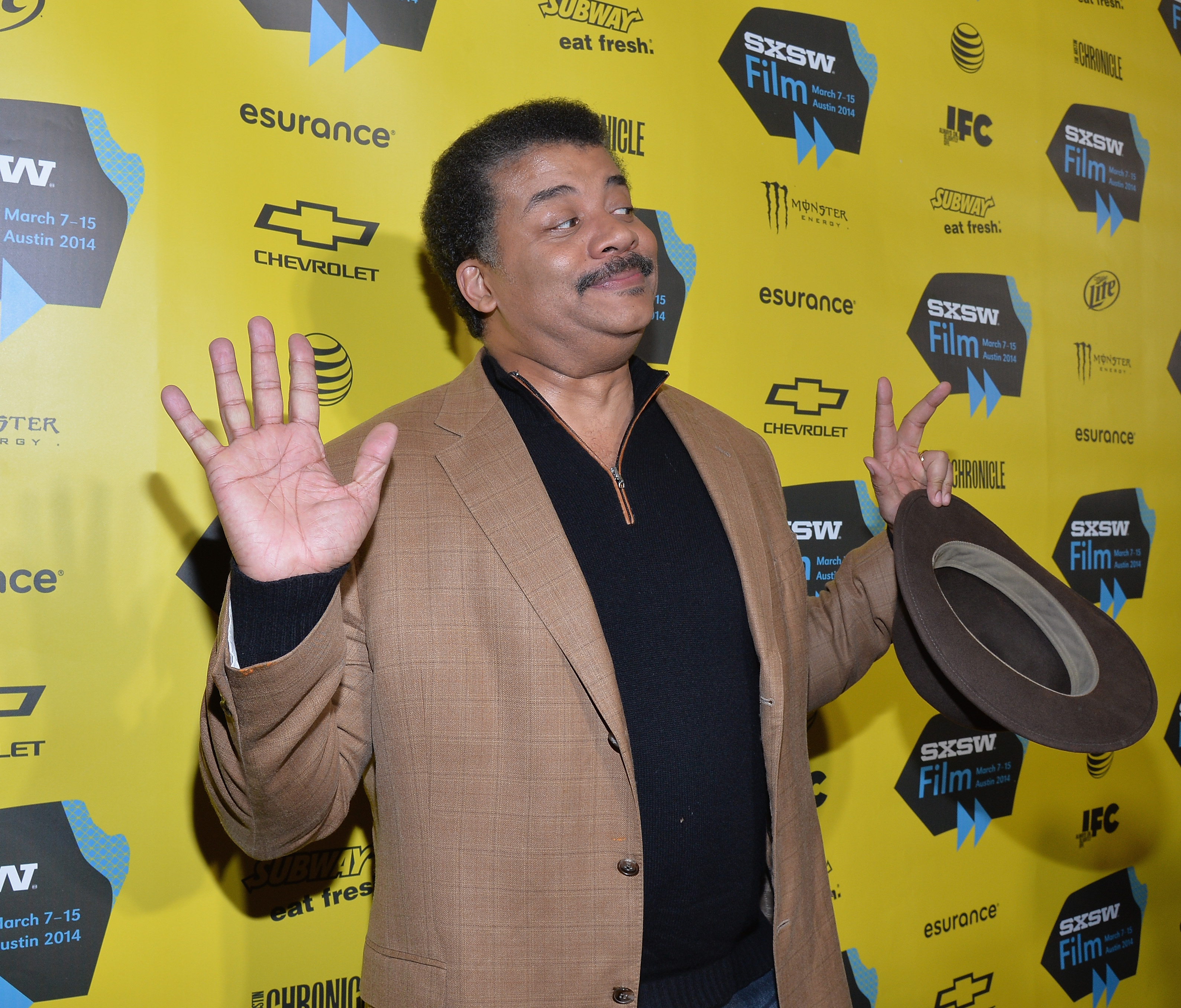 AUSTIN, TX - MARCH 07: Host Neil deGrasse Tyson arrives at the screening of 'Cosmos: A Space Time Odyssey during the 2014 SXSW Music, Film + Interactive at Paramount Theatre on March 7, 2014 in Austin, Texas. (Photo by Michael Buckner/Getty Images for SXSW)