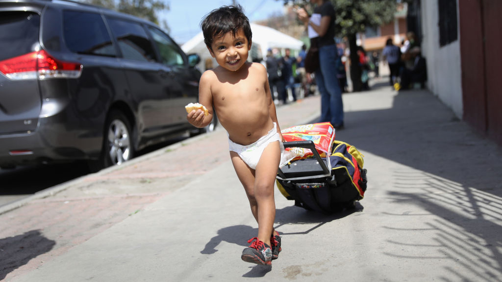 Honduran asylum seeker Daniel Once, 2, arrives to an immigrant shelter with his family on April 25, 2018 in Tijuana, Mexico. More than 300 immigrants, the remnants of a caravan of Central Americans that began almost a month ago, were arriving to Tijuana on the last leg of their journey north within Mexico. They plan to seek political asylum at the U.S. border this weekend. (Photo by John Moore/Getty Images)
